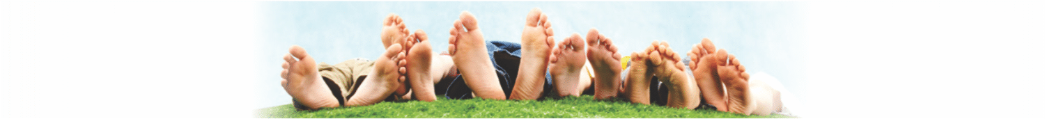 banner with multiple feet lined up lying in grass - Podiatrist Banner