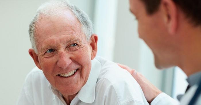doctor patting mans back - Friendly Podiatrist Sunshine Coast